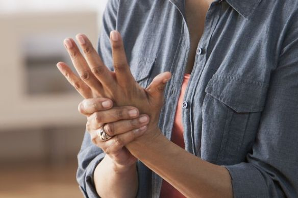 Older-Black-woman-rubbing-her-hands-Arthritis.jpg